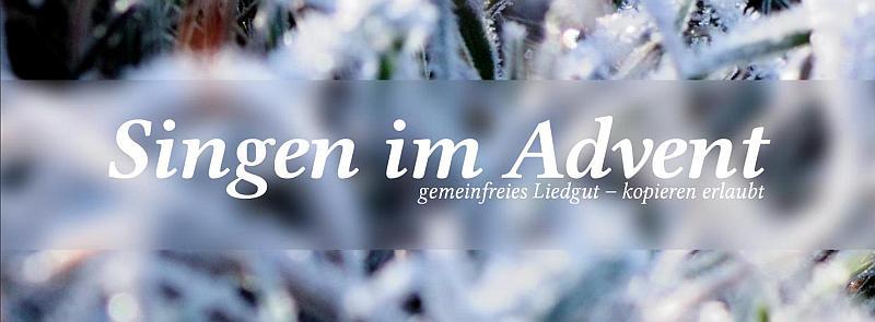 Schriftzug mit gefrorenem Gras im Hintergrund